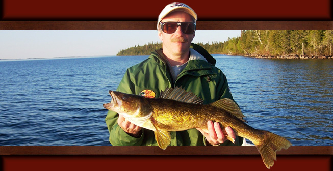 This is a picture of a man in a blue jacket holding a 5 pound Walleye