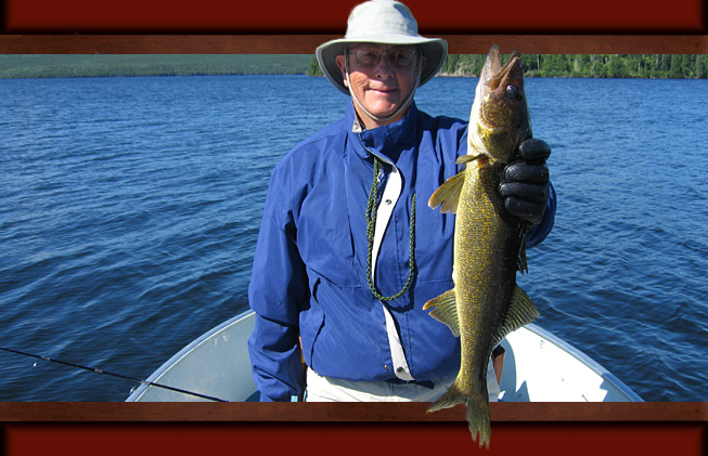 This is a picture of a man in a brown jacket holding up a 4.5 pound Walleye